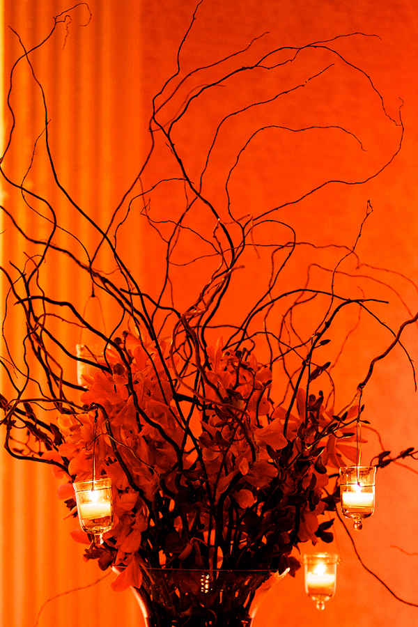 orange centerpiece with branches - hanging candles - wedding photo by top Philadelphia based wedding photographers Langdon Photography
