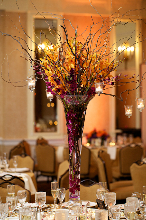 purple and yellow centerpiece with branches and hanging candles - wedding photo by top Philadelphia based wedding photographers Langdon Photography