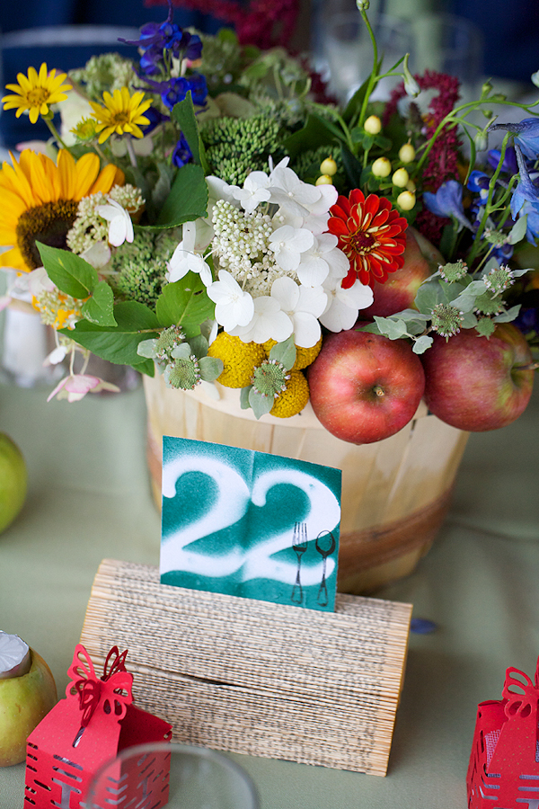 country inspired centerpiece with apples and flowers - paper table numbers - wedding photo by top Philadelphia based wedding photographers Langdon Photography