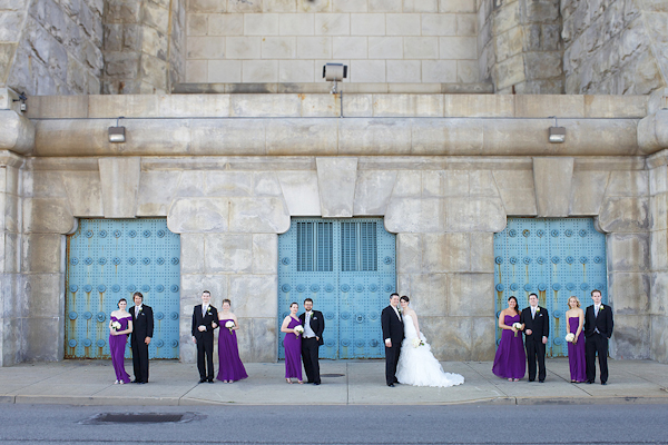 bride and groom pose with wedding party - purple bridesmaid dresses - wedding photo by top Philadelphia based wedding photographers Langdon Photography