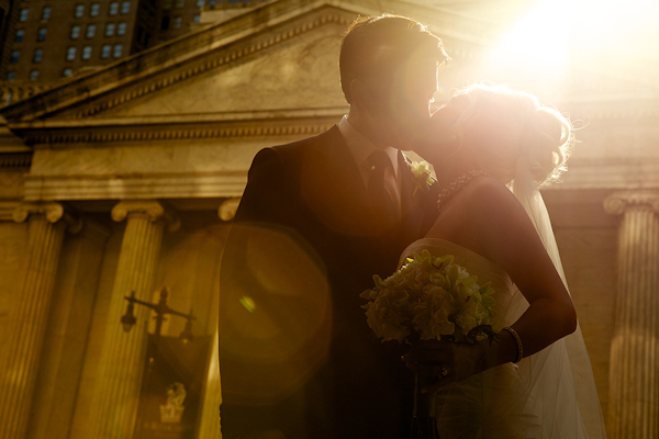 bride and groom kiss outside museum venue - wedding photo by top Philadelphia based wedding photographers Langdon Photography