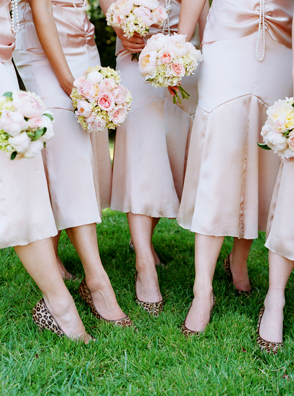Bridesmaids In Light Champagne Dresses And Leopard Print Shoes Posing With Pink Yellow