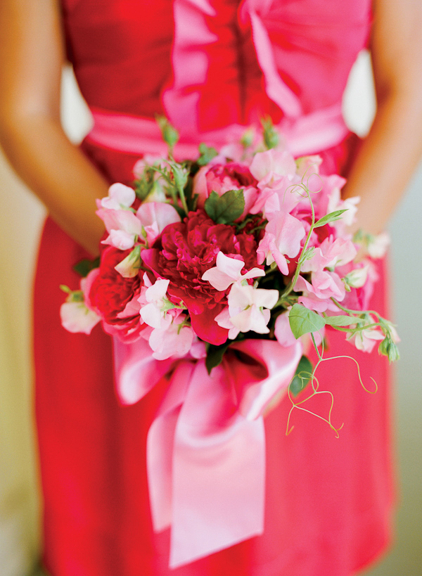 close up photo of bridesmaid's pink and red bouquet - photo by San Francisco based wedding photographer Lisa Lefkowitz