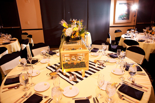 Reception table setting - Yellow tablecloth with black napkins and white ribbons tied to black chairs yellow birdcage with yellow gold orange green ... & Reception table setting - Yellow tablecloth with black napkins and ...
