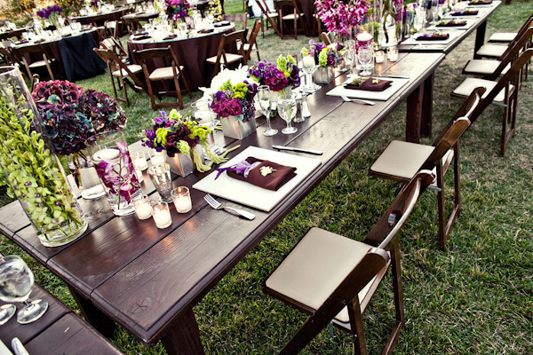 Table setting at outdoor reception - Purple, dark pink, and light ...