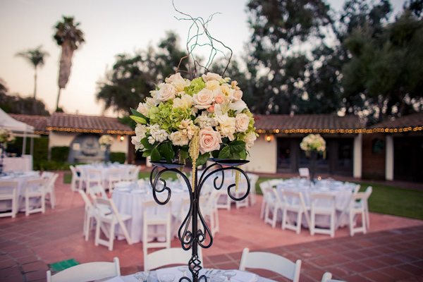 Beautiful centerpiece at outdoor wedding arrangement of light pink beautiful centerpiece at outdoor wedding arrangement of light pink peach light green ivory and white flowers attached to a black wrought iron junglespirit Gallery
