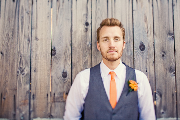 Groom Wearing Blue Vest And Orange Skinny Tie With An Fl Boutonniere Photo By