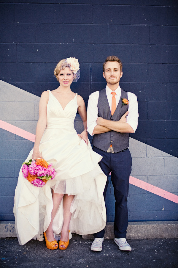 A Retro Style Birdcage Veil And Yellow Orange Shoes Carrying Dark Pink Light Green Bouquet With Groom Wearing Blue Vest Tie