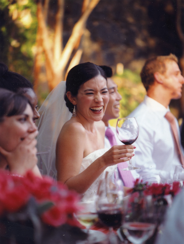 reception toasting - laughing bride - photo by San Francisco wedding photographer Meg Smith