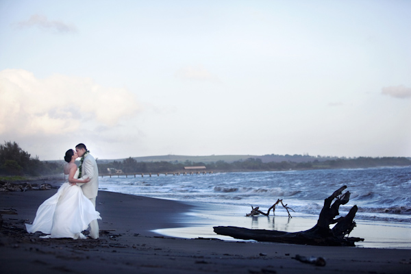 Bride In Strapless Ballgown And Groom Kiss On A Rustic