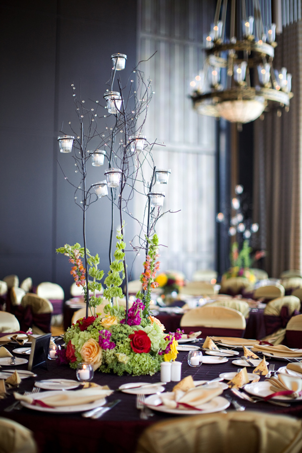 Modern centerpiece with hanging candles - wedding photo by Melissa Jill Photography