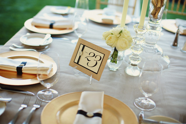 outdoor reception table setting with ivory and gold table number and matching linen decorations- photo by Northwest wedding photographer Michele Waite