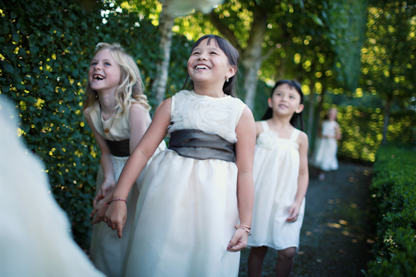 photo of adorable laughing flower girls - photo by Northwest wedding photographer Michele Waite