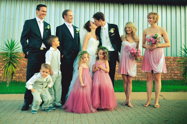 group portrait of wedding party - bridesmaids in pink and cream dresses - wedding photo by Australia based wedding photographer Natasha Du Preez