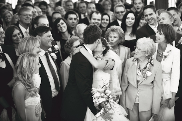 hilarious photo of guests encouraging the kiss - wedding photo by Australia based wedding photographer Natasha Du Preez