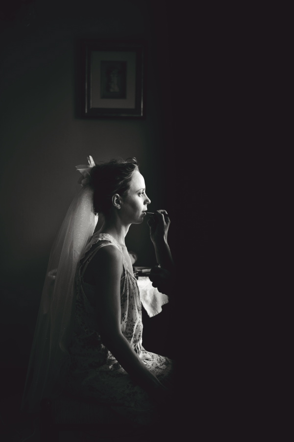 dramatic black and white photo of bride getting ready - wedding photo by Australia based wedding photographer Natasha Du Preez