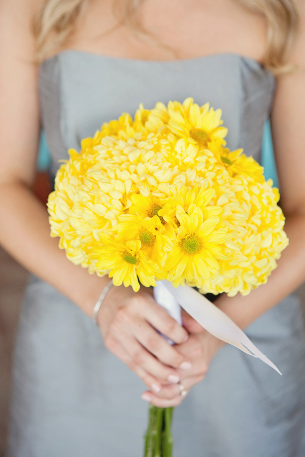 Bright and sunny yellow bridesmaid bouquet - Photo by April Smith & Co.