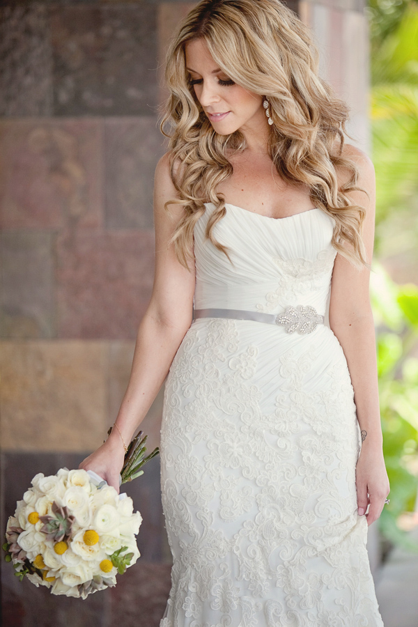Beautiful bride holding her modern white, yellow and gray bouquet - Photo by April Smith & Co.