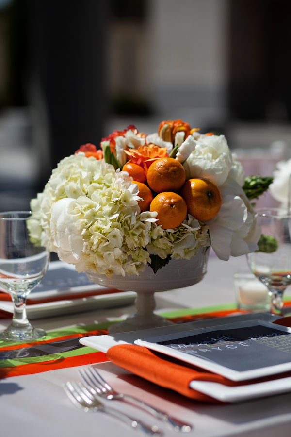 Orange and floral wedding reception centerpiece - Citrus Colored Wedding Decor Photo Shoot by Cadence Cornelius Photographs