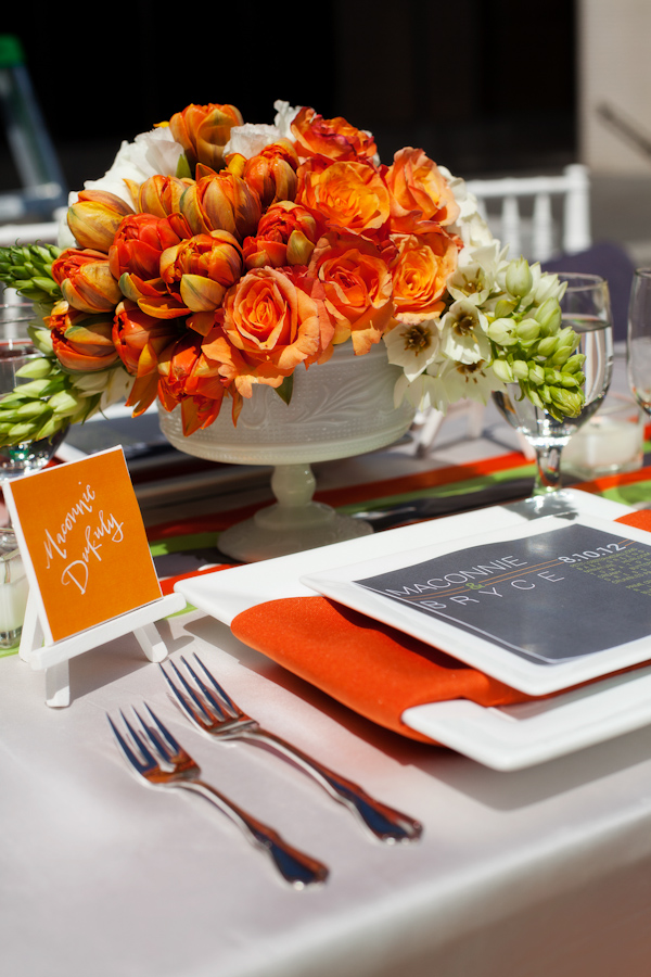 Orange citrus-inspired centerpieces for wedding reception table - Citrus Colored Wedding Decor Photo Shoot by Cadence Cornelius Photographs