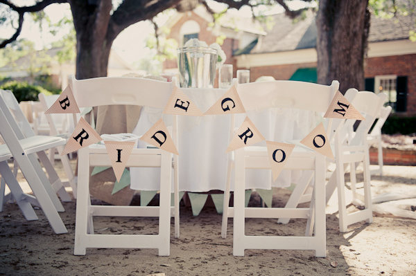 Bride and groom signs for a wedding reception seating arrangement - Wedding Photo by Elizabeth Davis