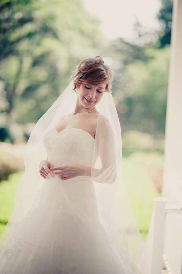 Bride in elegant wedding dress and veil - Wedding Photo by Elizabeth Davis