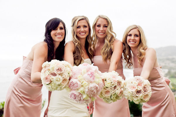 Bride and bridal party with bouquets - wedding photo by Focus Photography
