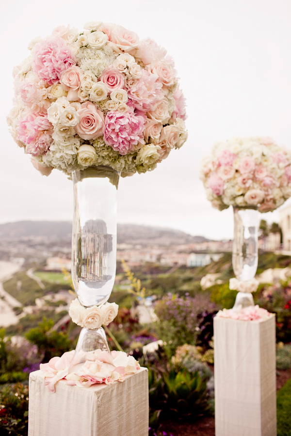 Ceremony florals and decor in pink and white - wedding photo by Focus Photography