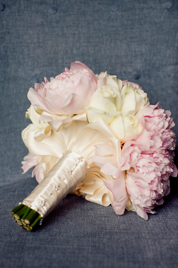 Bridal bouquet in light pink and cream with ivory ribbon stem wrap - wedding photo by Focus Photography