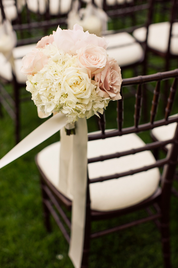 Soft floral aisle decoration in light pink and cream with ivory ribbon - wedding photo by Focus Photography