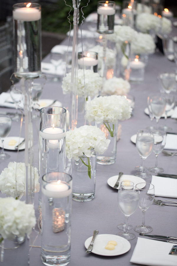 Wedding Photo by Miller and Miller Photography of silver and white table top decor