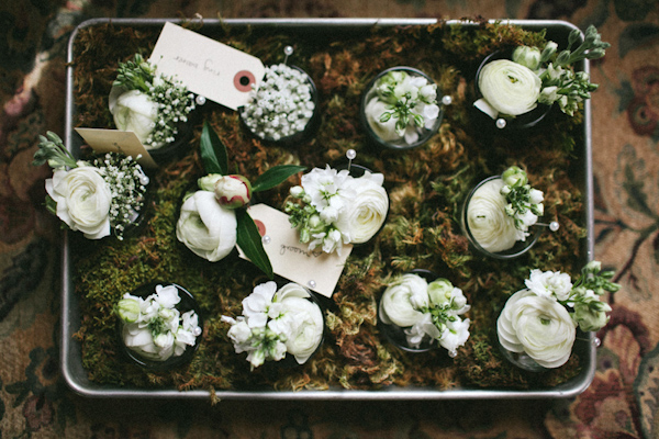 Rustic white wedding boutonnieres - Photo by The Schultzes