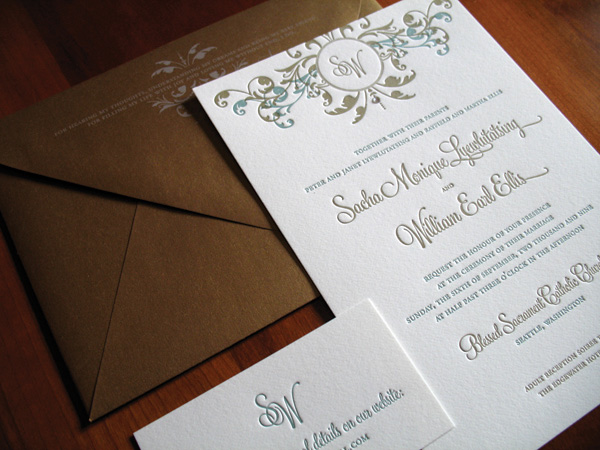 classic romantic style white wedding invitation with gold and blue font and floral swirls with gold envelope - photo of wedding invitations designed by Brown Sugar Designs