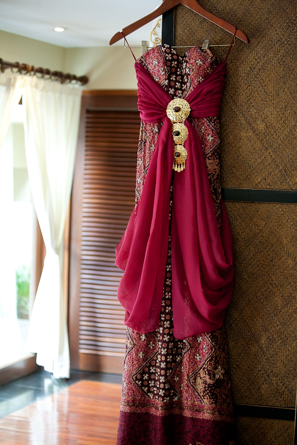 dark pink cultural dress hanging - traditional Indonesian wedding in Bali - photo by Portland wedding photographer Bunn Salarzon