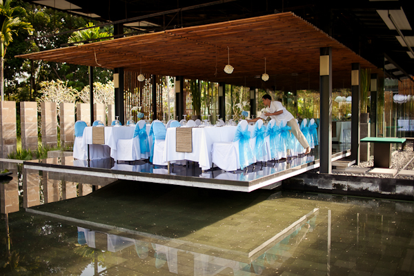 blue ribbons tied on white chairs in reception area overlooking reflection pool - traditional Indonesian wedding in Bali - photo by Portland wedding photographer Bunn Salarzon