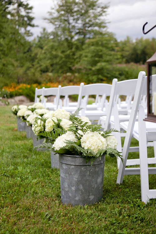 Rustic ivory hydrangea aisle decor for outdoor wedding - Photo by Emily Delamater