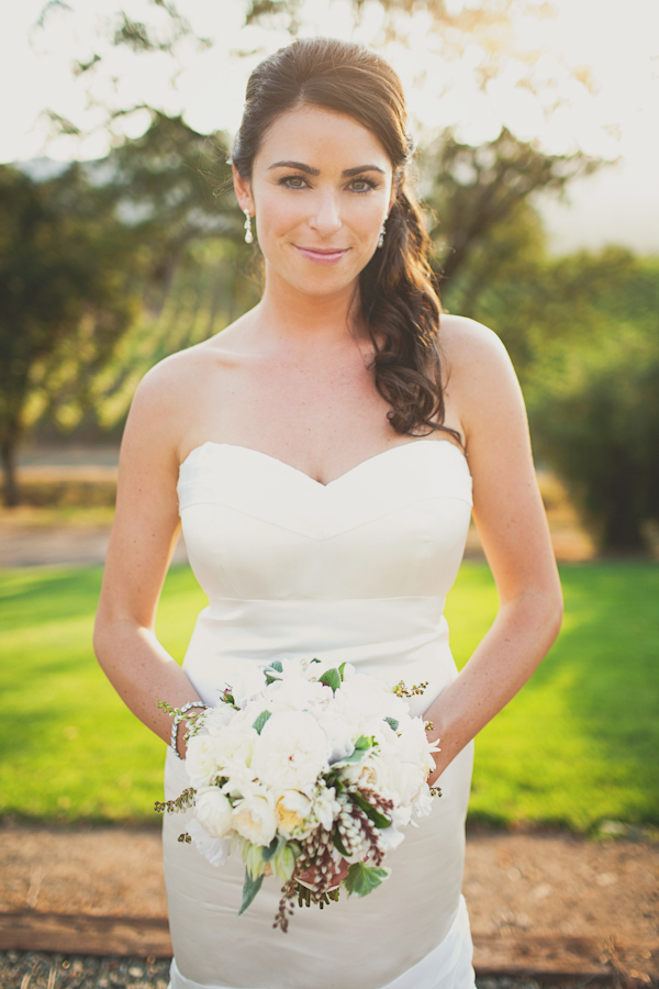 bride in white mermaid dress with side ponytail holding bouquet - warm, sunny, Sonoma California vineyard wedding photo by California wedding photographers EP Love