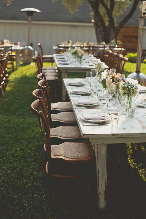 outdoor reception seating with vintage feel - warm, sunny, Sonoma California vineyard wedding photo by California wedding photographers EP Love
