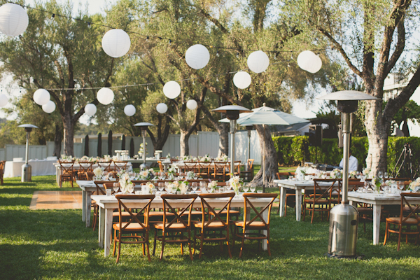 paper lanterns hang over outdoor reception seating - warm, sunny, Sonoma California vineyard wedding photo by California wedding photographers EP Love