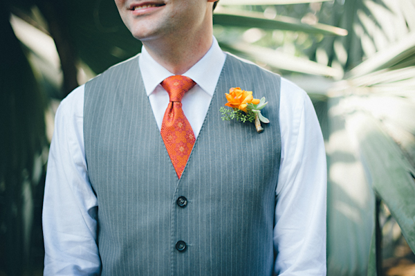 detail shot of groom's orange boutonniere, gray pinstriped vest, and orange tie -  Sayulita, Mexico destination wedding photo by Mexico wedding photographer Jillian Mitchell