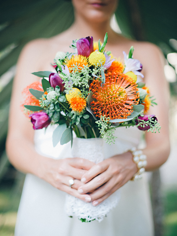 bride's assorted bouquet of orange, green and dark pink/purple florals - Sayulita, Mexico destination wedding photo by Mexico wedding photographer Jillian Mitchell