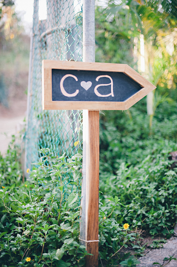 arrow shaped chalkboard sign with the couples initials - Sayulita, Mexico destination wedding photo by Mexico wedding photographer Jillian Mitchell