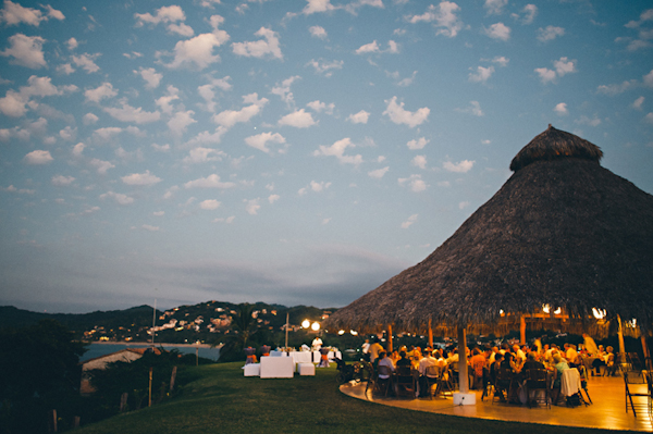 outdoor reception site with grass room and cliffside view - Sayulita, Mexico destination wedding photo by Mexico wedding photographer Jillian Mitchell