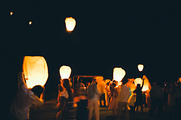 guests release lanterns into the sky - Sayulita, Mexico destination wedding photo by Mexico wedding photographer Jillian Mitchell