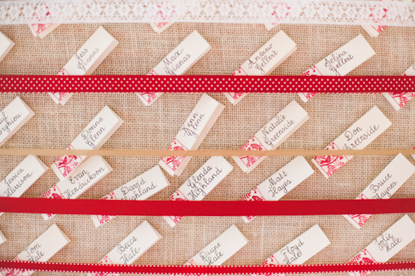 Creative red, white and burlap place card chart - Photo by Michelle Warren Photography