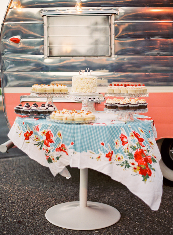 Beutiful dessert table on blue and red floral tablecloth - Photo by Michelle Warren Photography