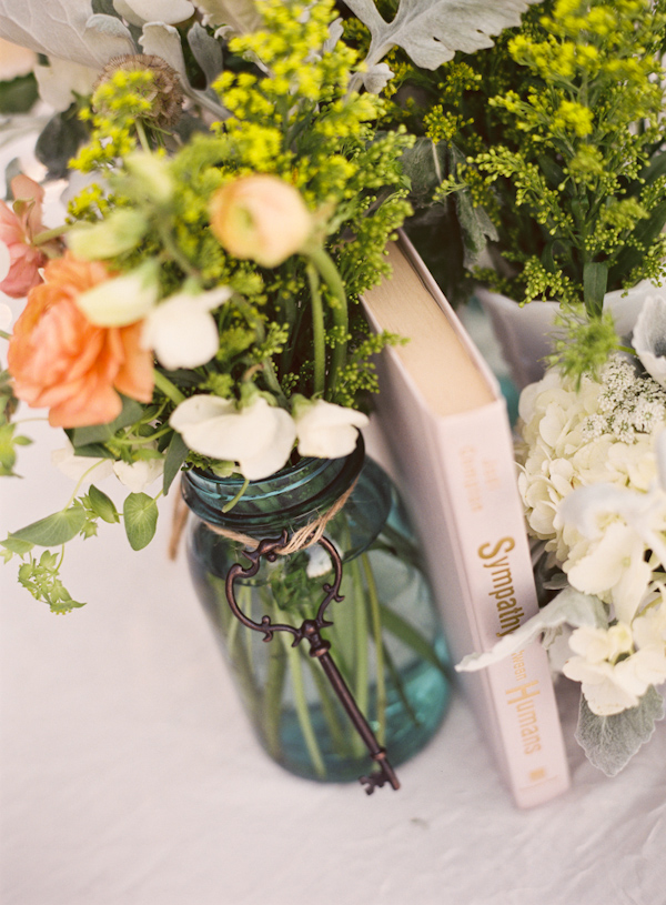 Vintage book and floral tabletop decor - Photo by Michelle Warren Photography