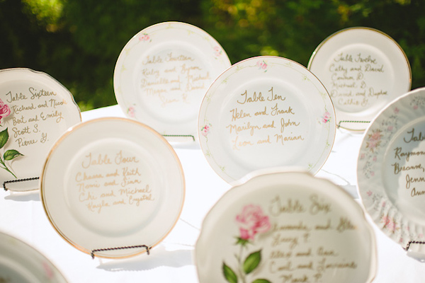 Beautiful vintage inspired plates with hand-written table assignments - Photo by Nordica Photography