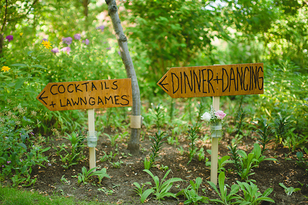 Rustic wedding reception signs leading to Dinner + Dancing and Cocktails + Lawngames - Photo by Nordica Photography