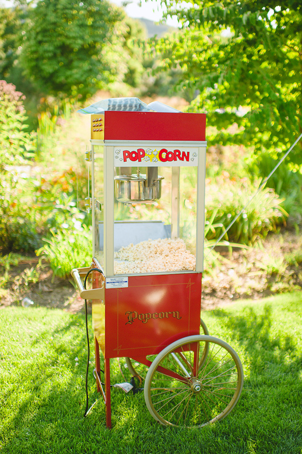 Vintage style popcorn machine for outdoor wedding reception - Photo by Nordica Photography